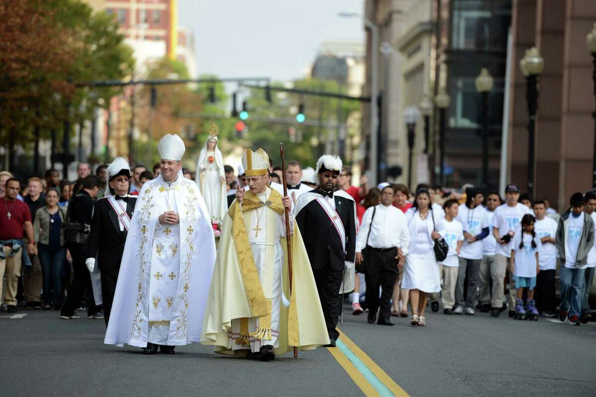 Bishop Caggiano and area clergy and youth walk in a procession with the statue of the Blessed Mother through downtown Bridgeport Saturday, Sept. 19, 2015 to the Webster Bank Arena for the Diocese of Bridgeport Synod Celebration. The closing Mass of Synod 2014 is the culmination of an 18-month journey of renewal for the Diocese of Bridgeport.