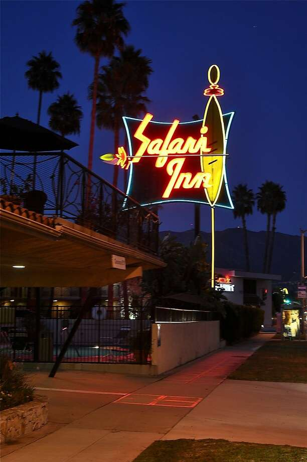"""The casual Safari Inn and its neon surfboard sign in Burbank have featured in movies and TV shows such as """"Apollo 13"""" and """"CSI Miami."""" Photo: Kimberley Lovato, Special To The Chronicle"""