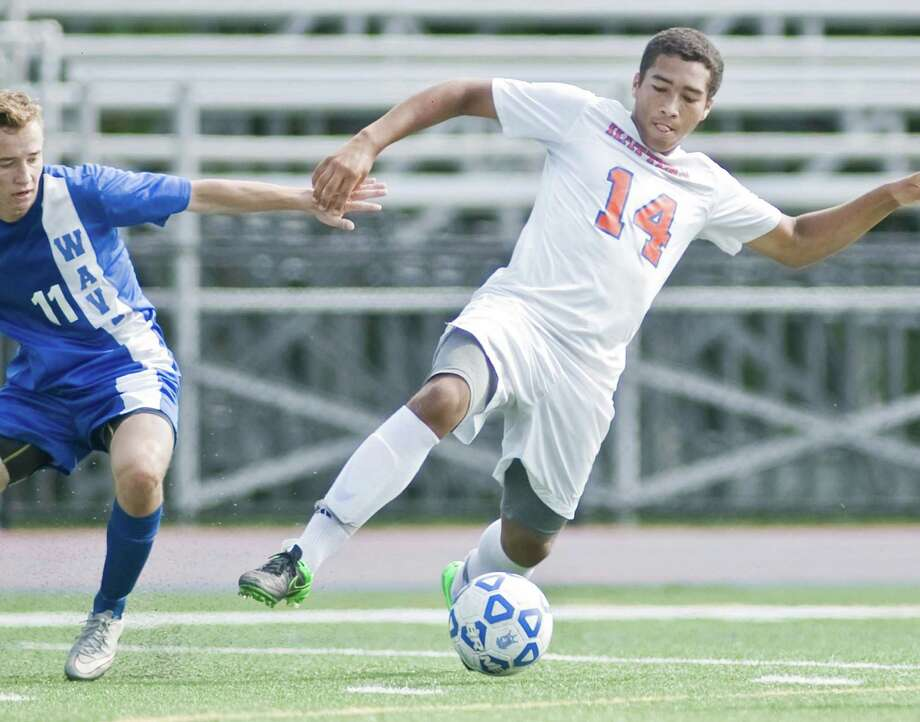 Danbury High School's Justin Warren takes control of the ball in a game against Darien High School, played at Danbury. Saturday, Sept. 19, 2015 Photo: Scott Mullin / For The / The News-Times Freelance