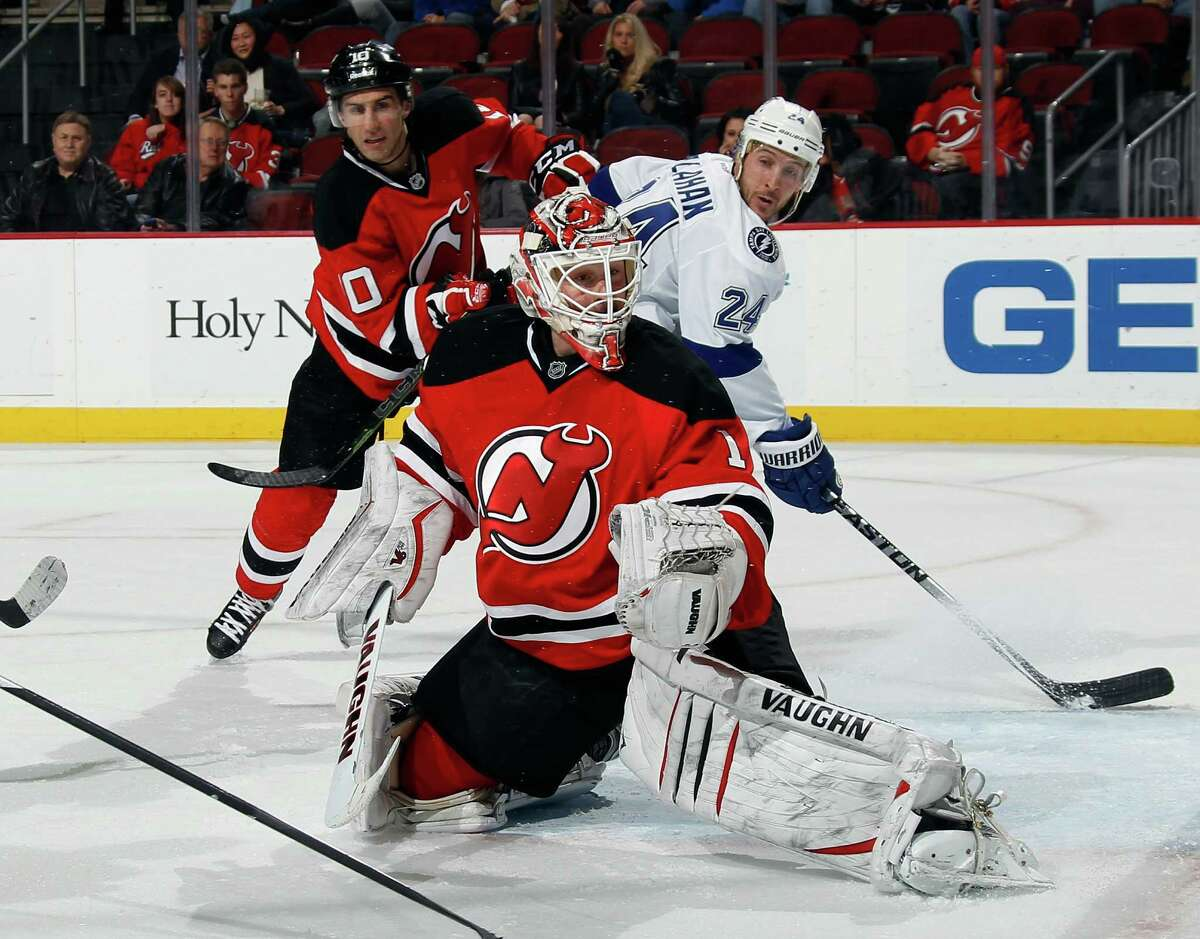 NEWARK, NJ - DECEMBER 19: Keith Kinkaid #1 of the New Jersey Devils makes the third period save against the Tampa Bay Lightning at the Prudential Center on December 19, 2014 in Newark, New Jersey. The Devils defeated the Lightning 3-2 in the shootout. (Photo by Bruce Bennett/Getty Images) ORG XMIT: 507048343