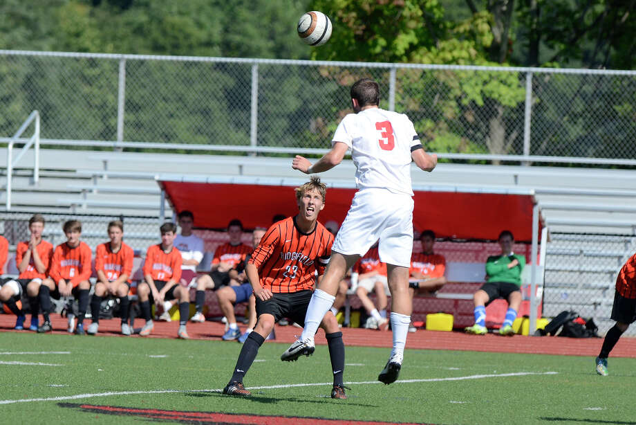 Greenwich #3 Nick Bartels heads the ball near Ridgefield's Matt Wilson as Ridgefield High School challenges Greenwich High School in boys varsity soccer at Greenwich High School in Greenwich, CT  on Sept. 19, 2015. Photo: Shelley Cryan / For Hearst Connecticut Media / Stamford Advocate Freelance