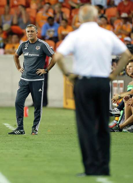 Dynamo coach Owen Coyle, left, stared down his predecessor, San Jose coach Dominic Kinnear, during the first half of the teams' matchup last month at BBVA Compass Stadium, a game the Dynamo won 2-1. Photo: James Nielsen, Staff / © 2015  Houston Chronicle