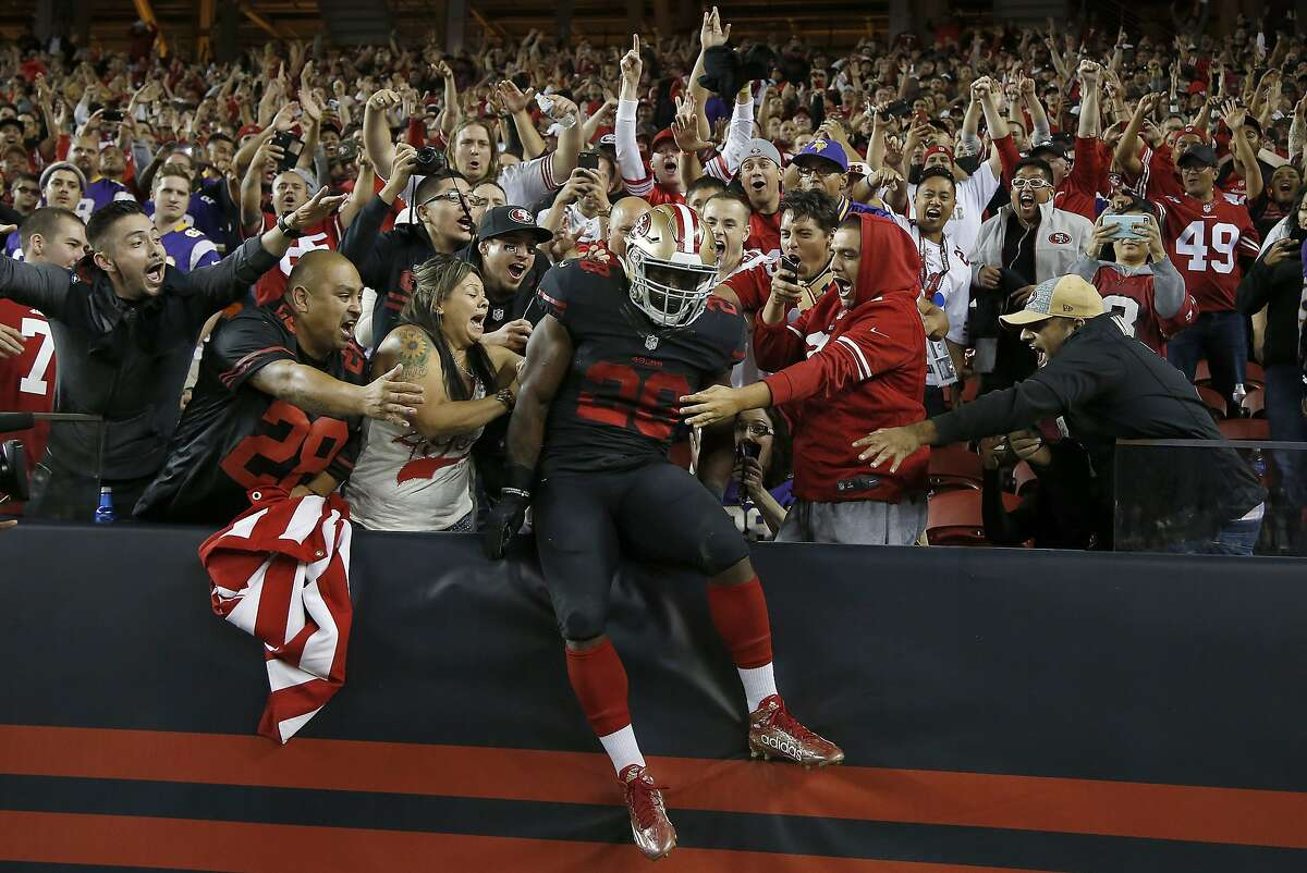 San Francisco 49ers running back Carlos Hyde, center, celebrates with fans after scoring on a 17-yard touchdown run against the Minnesota Vikings during the second half of an NFL football game in Santa Clara, Calif., Monday, Sept. 14, 2015. (AP Photo/Tony Avelar)