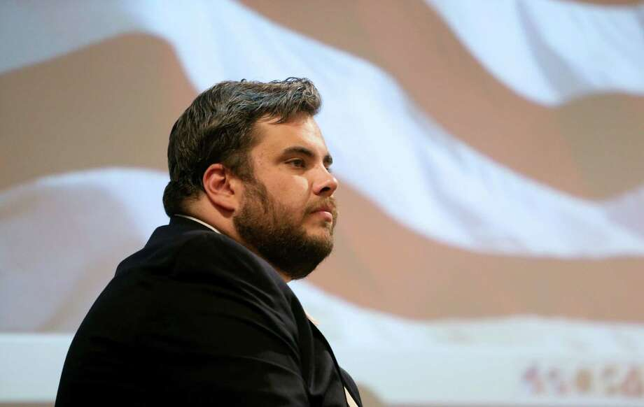 State Rep. Jonathan Stickland (R-Bedford) moderates a talk given by Wallace Hall, president of Wetland Partners, at the North East Tarrant Tea Party meeting at the North Richland Hills Centre Monday, Aug. 10, 2015, in North Richland Hills, Texas. Wetland Partners operates the Trinity River Mitigation Bank, a wetlands bank created for the purpose of mitigating U.S. Army Corps of Engineers approved environmental impacts to the aquatic system per the Clean Water Act. Public and private companies that need a federal permit to destroy wetlands can pay a mitigation bank, which in exchange restores or enhances wetlands. Photo: Gary Coronado, Houston Chronicle / © 2015 Houston Chronicle
