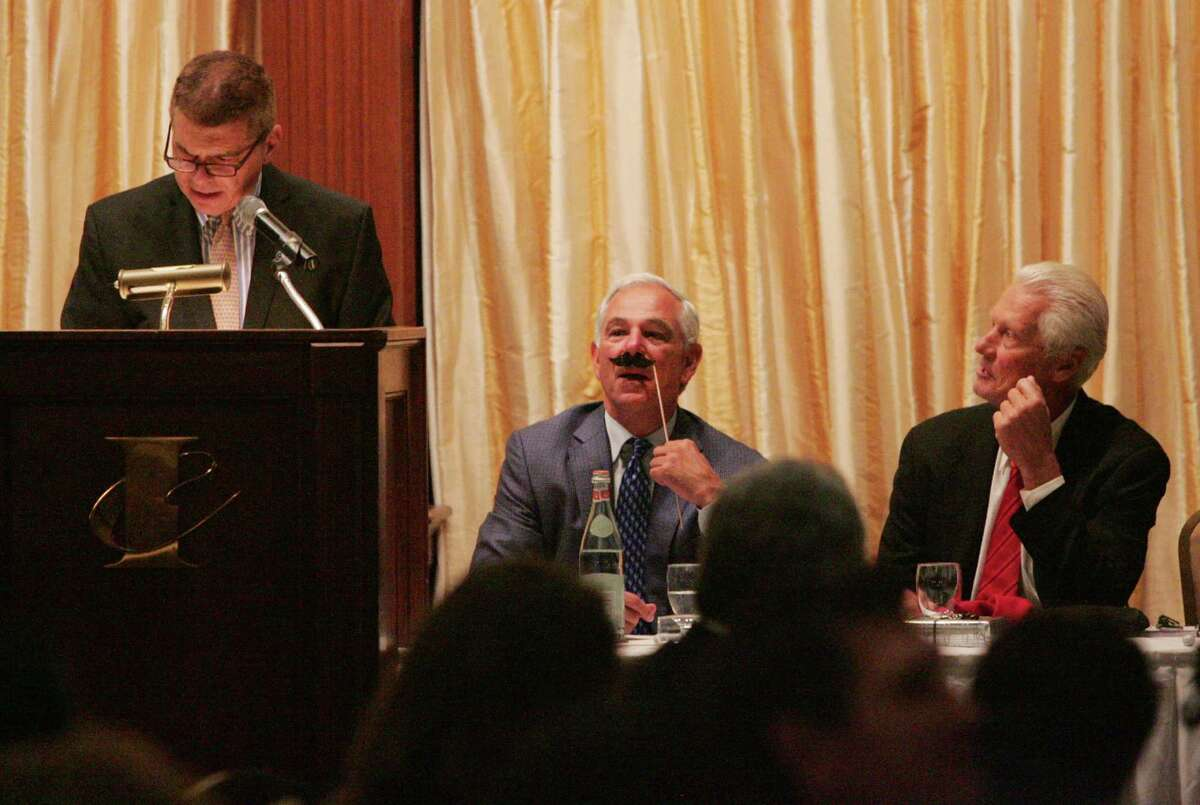 """Bobby Valentine, center, plays with a mustache, as Master of Ceremonies WFAN's Ed Randall, left, gets things underway during the American Cancer Society's annaul """"Local Philanthropist Roast"""" at the Italian Center in Stamford on Thursday Sept. 17, 2015. At right is Tom Paciorek."""