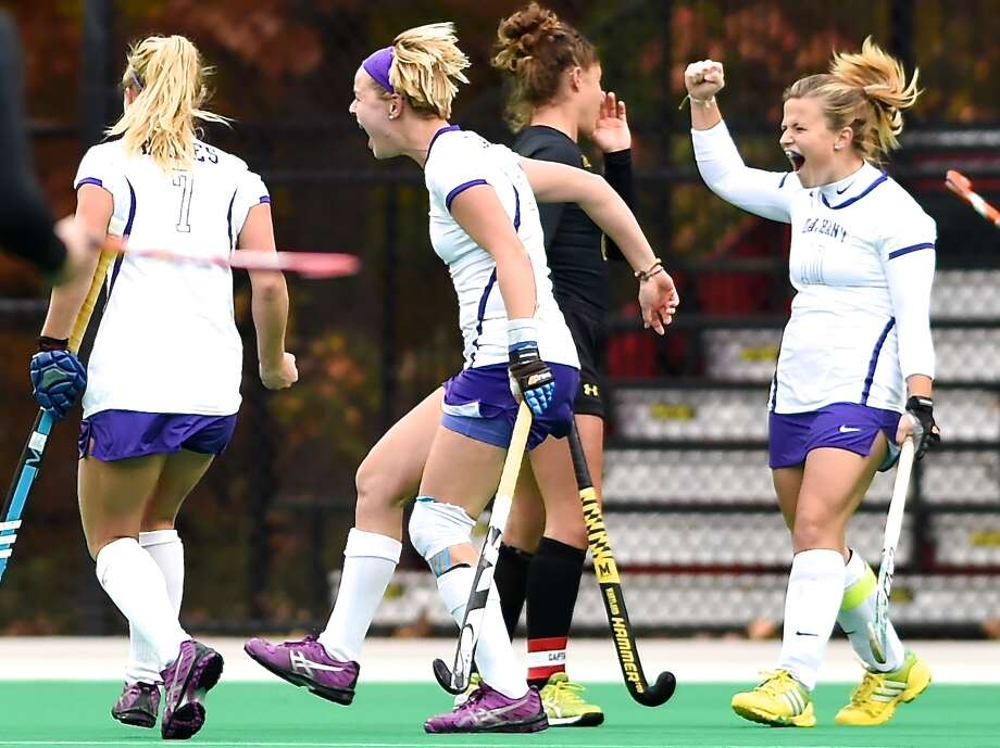 The University at Albany field hockey team celebrates an NCAA Tournament victory over Maryland that puts the Great Danes in the Final Four. (Beth Strauss)