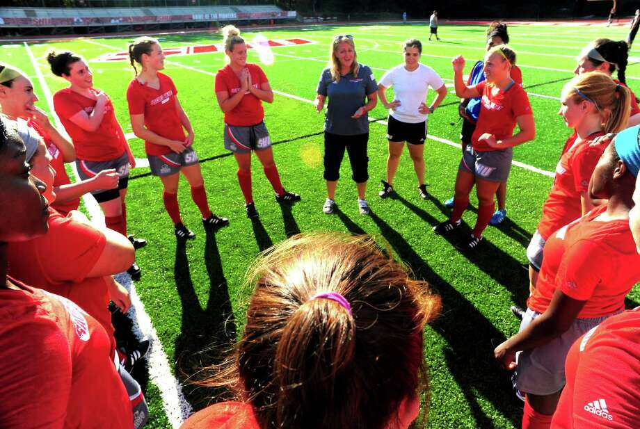 Sacred Heart University Women's Rugby team practices on Campus Field in Fairfield, Conn. on Friday Sept. 11, 2015. This is the first season for the program, led by Coach Michelle Reed, at top center. Photo: Christian Abraham / Hearst Connecticut Media / Connecticut Post