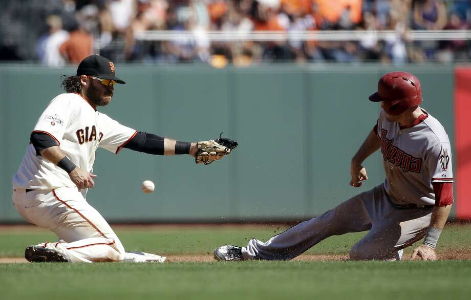 Arizona Diamondbacks' A.J. Pollock, right, steals second base next to San Francisco Giants shortstop Brandon Crawford on Sept. 19, 2015, in San Francisco. (AP Photo/Marcio Jose Sanchez) Photo: Marcio Jose Sanchez, Associated Press