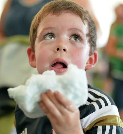 Five-year-old Braeden Green of Glenville listens to traditional Irish music at the 19th Annual Irish 2000 Music and Arts FestivalOs at the Saratoga County Fairgrounds Saturday Sept. 19, 2015 in Ballston Spa, NY.  (John Carl D'Annibale / Times Union) Photo: John Carl D'Annibale / 00033379A