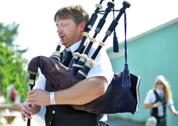 Schenectady Pipe Band's Jeff Schenck of Duanesbug warms up before their performance at the 19th Annual Irish 2000 Music and Arts FestivalOs at the Saratoga County Fairgrounds Saturday Sept. 19, 2015 in Ballston Spa, NY.  (John Carl D'Annibale / Times Union) Photo: John Carl D'Annibale / 00033379A
