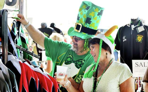 Terry Miller, left, and his wife Anna Miller shop at the 19th Annual Irish 2000 Music and Arts Festival's at the Saratoga County Fairgrounds Saturday Sept. 19, 2015 in Ballston Spa, NY.  (John Carl D'Annibale / Times Union) Photo: John Carl D'Annibale / 00033379A