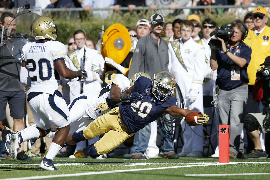 Notre Dame's C.J. Prosise dives into the end zone for a 17-yard touchdown against Georgia Tech in the second quarter. Photo: Joe Robbins, Getty Images