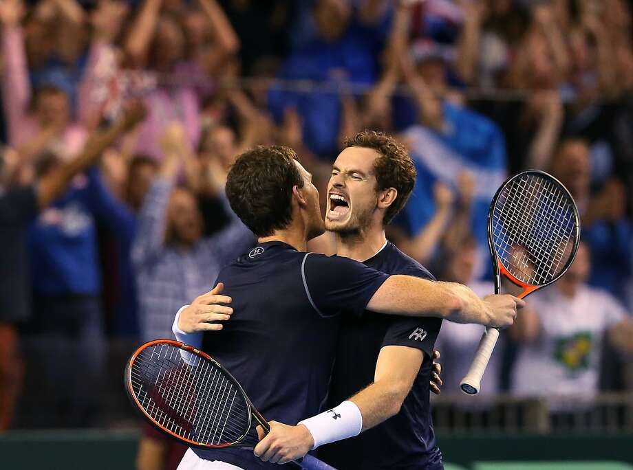 Andy Murray (right) and Jamie Murray show some brotherly love. Photo: Scott Heppell, Associated Press