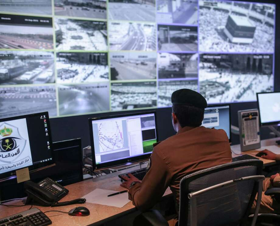 A Saudi security officer monitors surveillance screens with live views of Muslim pilgrims in the holy city of Mecca, along with highways and high density areas, a few days before the start of the annual pilgrimage known as the hajj in Mecca, Saudi Arabia, on Saturday. Photo: Mosa'ab Elshamy, STF / AP
