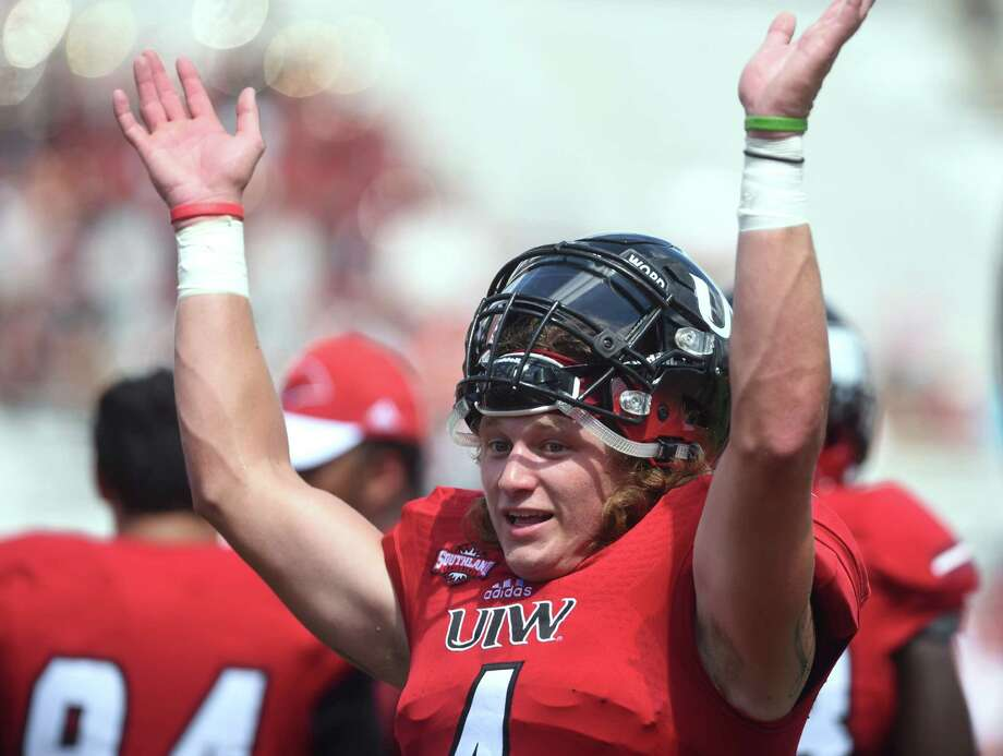 Incarnate Word quarterback Trent Brittain shows how tight end Cole Wick waved his arms to show that he was open in the end zone for a touchdown pass during college football action against Nicholls State at Benson Stadium on Saturday, Sept. 19, 2015. Photo: Billy Calzada, Staff / San Antonio Express-News / San Antonio Express-News