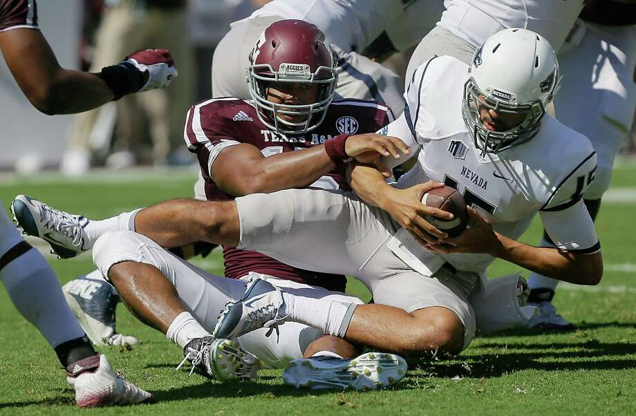 Tyler Stewart of the Nevada Wolf Pack is sacked by Myles Garrett of the Texas A&M Aggies in the first quarter at Kyle Field on Sept. 19, 2015 in College Station. Photo: Bob Levey /Getty Images / 2015 Getty Images