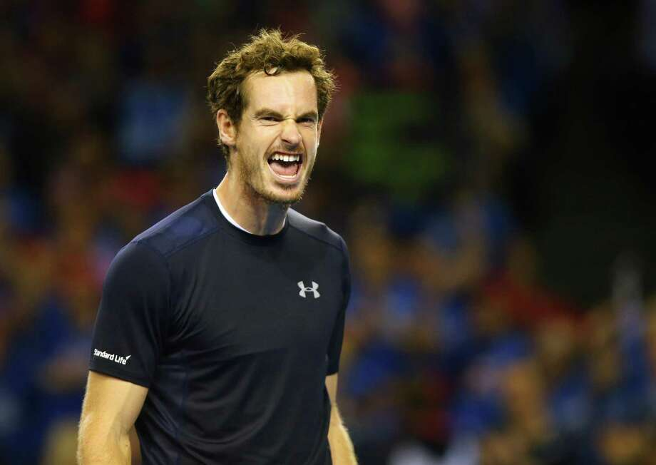 Andy Murray of Great Britain celebrates victory during the Davis Cup doubles match between Andy Murray and Jamie Murray of Great Britain and Lleyton Hewitt and Sam Groth of Australia at The Emirates Arena in Glasgow, Scotland on September 19, 2015.  AFP PHOTO / IAN MACNICOLIan MacNicol/AFP/Getty Images ORG XMIT: 4418 Photo: IAN MACNICOL / IAN MACNICOL/AFP
