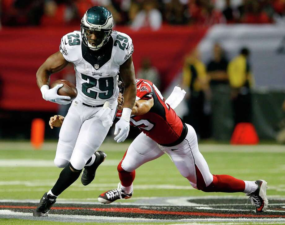 ATLANTA, GA - SEPTEMBER 14:  DeMarco Murray #29 of the Philadelphia Eagles breaks a tackle by Paul Worrilow #55 of the Atlanta Falcons during the first half  at the Georgia Dome on September 14, 2015 in Atlanta, Georgia.  (Photo by Kevin C. Cox/Getty Images) Photo: Kevin C. Cox, Staff / Getty Images / 2015 Getty Images