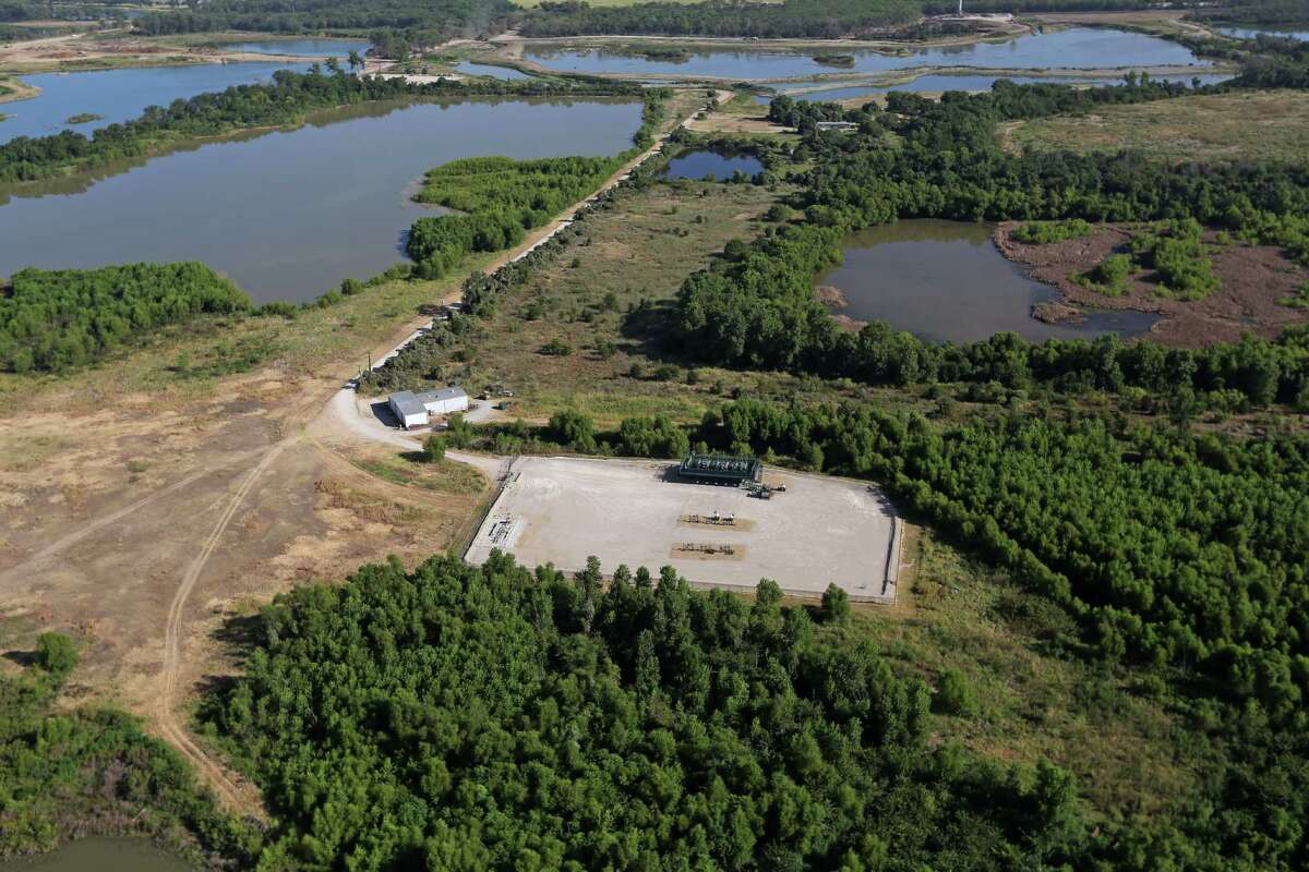 A Chesapeake Energy natural gas pad sits within the boundaries of the Trinity River Mitigation Bank, owned by Wallace Hall.