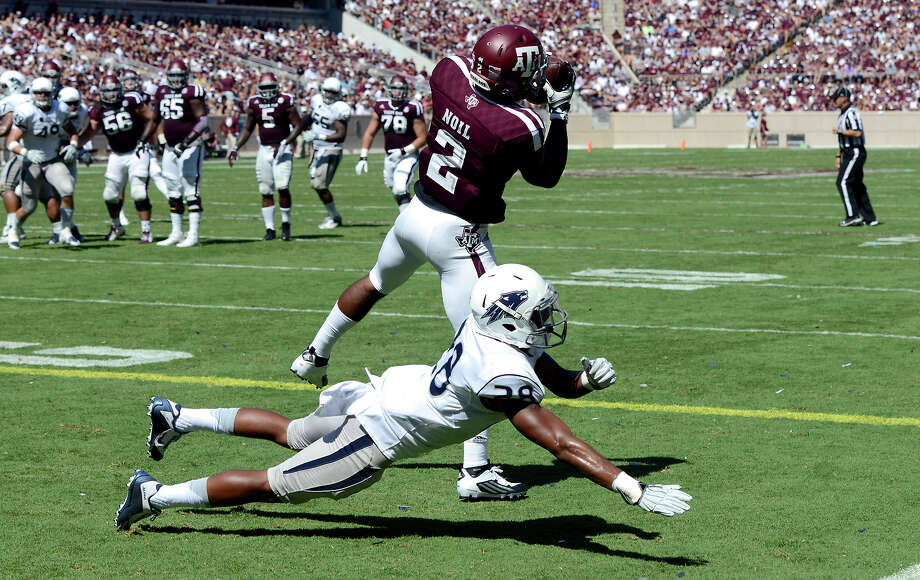 Texas A&M's Speedy Noil (2) catches a pass for a touchdown as Nevada's Elijah Mitchell (28) falls down in the endzone during the second half of an NCAA college football game Saturday, Sept. 19, 2015, in College Station, Texas. (Sam Craft/College Station Eagle via AP) MANDATORY CREDIT Photo: Sam Craft, MBR / College Station Eagle