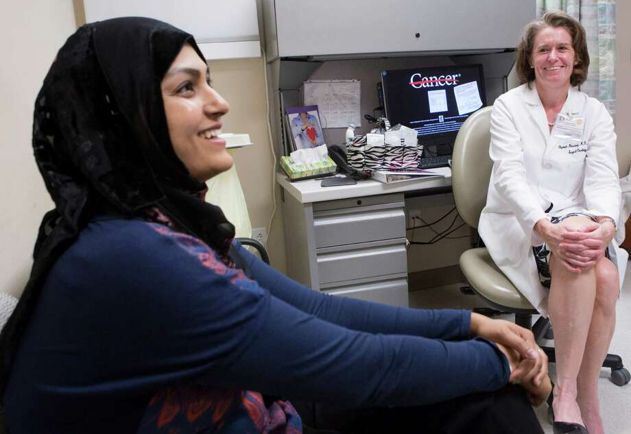 Sadaf Zaidi, left, a recently recovered breast cancer patient accepts an invitation by Dr. Elizabeth Mittendorf of M.D. Anderson Cancer Center to participate on the clinical trial of a vaccine that shows promise for preventing the recurrence of breast cancer. Photo: Marie D. De Jesus, Staff / © 2015 Houston Chronicle