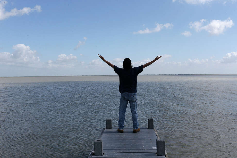Iraq War veteran Sabastian Vasquez, 32, finds peace while meditating on the Austwell Pier near his hometown of Tivoli, Texas, Wednesday, August 6, 2015. Vasquez made three tours in Iraq and was diagnosed with Post-Traumatic Stress Disorder. The U.S. Marine left the service in 2005 and ten years later he is still dealing with the PTSD. Photo: Photos By Jerry Lara / San Antonio Express-News / © 2015 San Antonio Express-News