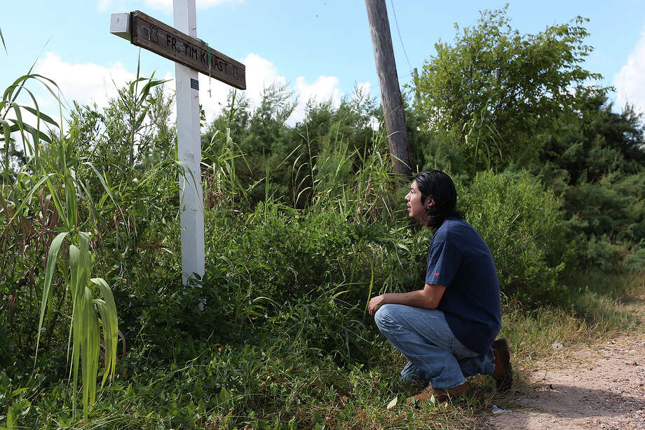 Iraq War veteran Sabastian Vasquez, 32, pays his respect at a memorial for family friend and parish priest, Tim Kinast, by the Austwell Pier near his hometown of Tivoli, Texas, Wednesday, August 6, 2015. Vasquez made three tours in Iraq and was diagnosed with Post-Traumatic Stress Disorder. The U.S. Marine left the service in 2005 and ten years later he is still dealing with the PTSD. Kinast was a close family friend and died while kayaking in 2003. Photo: JERRY LARA, Staff / San Antonio Express-News / © 2015 San Antonio Express-News