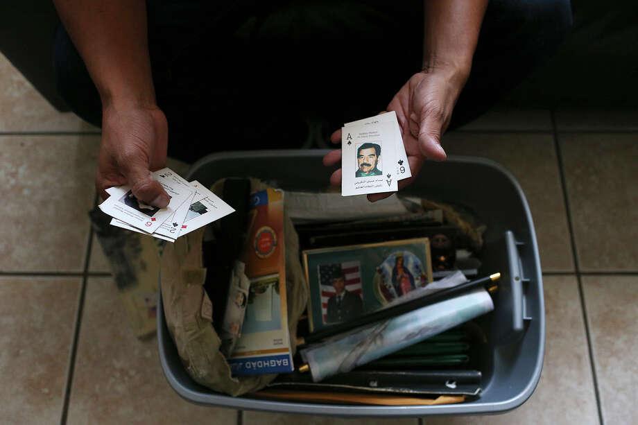 Bocanegra, 32, looks war mementos while sitting in the living room of his apartment in McAllen. Photo: JERRY LARA / San Antonio Express-News / © 2015 San Antonio Express-News