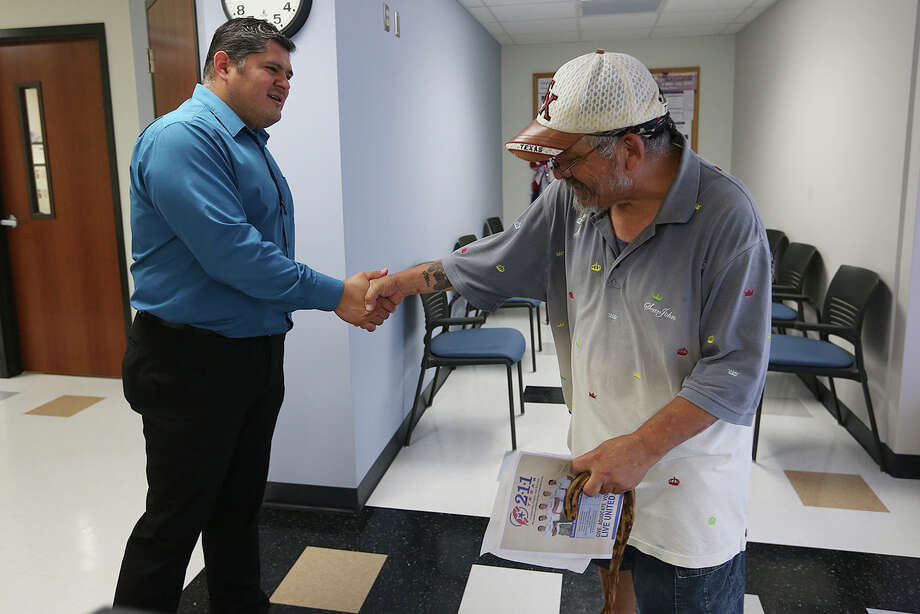 Cameron County Veterans Services Director Salvador J. Castillo greets U.S. Army veteran Jose Barron, 56, at the services offices in Brownsville, Texas, Wednesday, July 22, 2015. Castillo is charged with helping military veterans with benefits due to them through the Veterans Department. Photo: JERRY LARA, Staff / San Antonio Express-News / © 2015 San Antonio Express-News