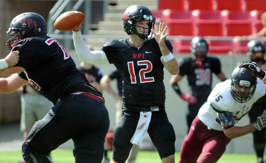 RPI's quarterback Jeff Avery, center, aims his pass during their football game against MIT on Saturday, Sept. 19, 2015, at Rensselaer Polytechnic Institute in Troy, N.Y. (Cindy Schultz / Times Union) Photo: Cindy Schultz / 00033372A