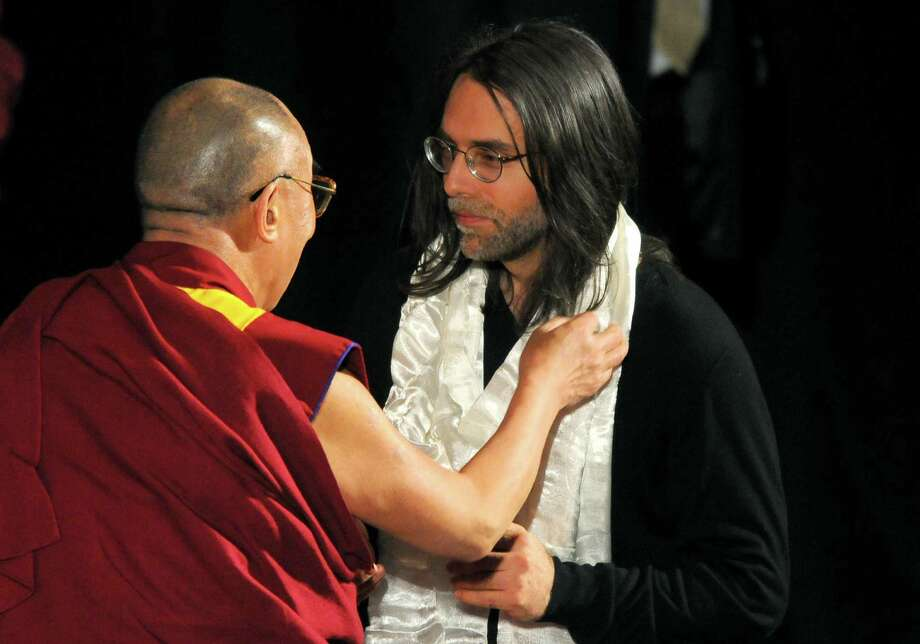 Keith Raniere, right, the founder of NXIVM, meets the Dalai Lama at the Palace Theatre in 2009. Raniere has been accused by a former NXIVM insider of directing financial probes of federal judges and a U.S. senator, among others. (Philip Kamrass/Times Union archive) Photo: Philip Kamrass