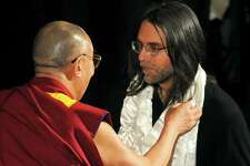 Keith Raniere, right, the founder of NXIVM, meets the Dalai Lama at the Palace Theatre in 2009. Raniere has been accused by a former NXIVM insider of directing financial probes of federal judges and a U.S. senator, among others. (Philip Kamrass/Times Union archive)