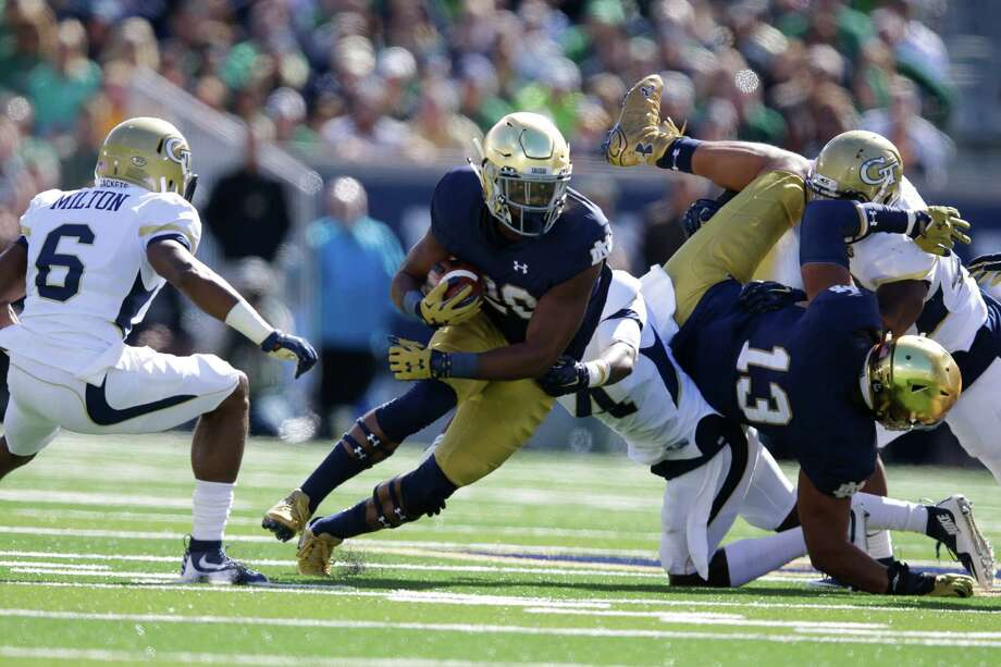 Notre Dame running back C.J. Prosise (20) cuts in front of Georgia Tech defensive back Chris Milton (6) during the first half of an NCAA college football game in South Bend, Ind., Saturday, Sept. 19, 2015. (AP Photo/Michael Conroy) Photo: Michael Conroy, STF / AP