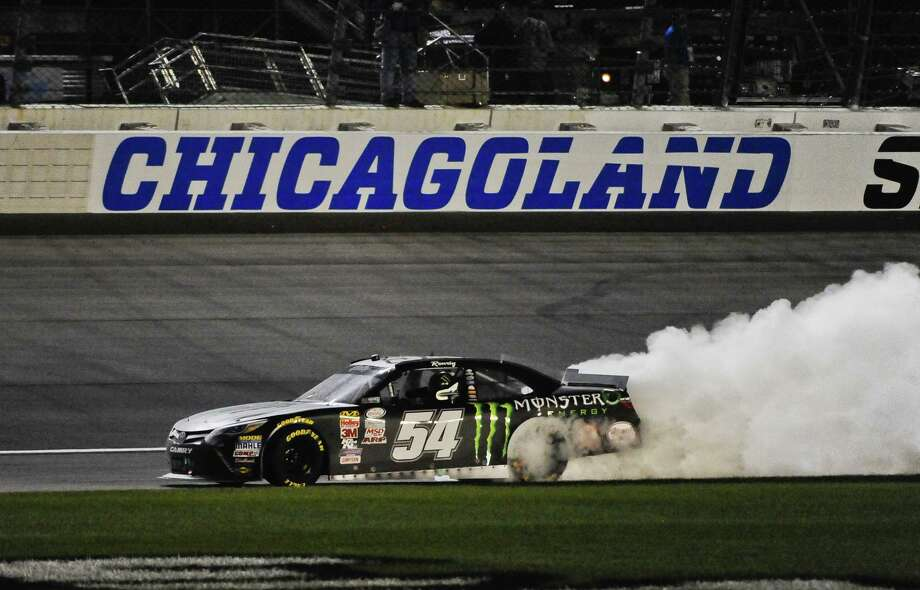 Kyle Busch does a burn out after he wins the NASCAR Xfinity Series auto race at Chicagoland Speedway, Saturday, Sept. 19, 2015, in Joliet, Ill. (AP Photo/Matt Marton) ORG XMIT: ILMM234 Photo: Matt Marton / FR170980AP