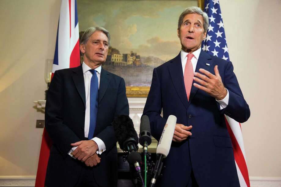 Secretary of State John Kerry discussed the situation in Syria while holding a news conference with  British Foreign Secretary Philip Hammond. Photo: Evan Vucci / New York Times / POOL