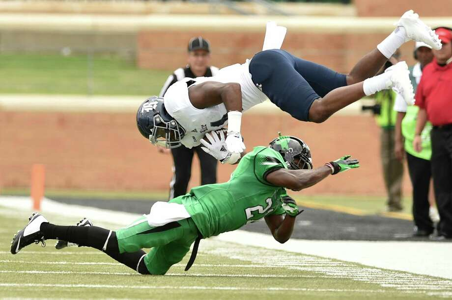 North Texas junior defensive back James Gray (21) upends Rice senior aide receiver Dennis Parks (4), Saturday, September 19, 2015, at Apogee Stadium in Denton, TX. David Minton/DRC Photo: David Minton, Denton Record-Chronicle / Denton Record-Chronicle