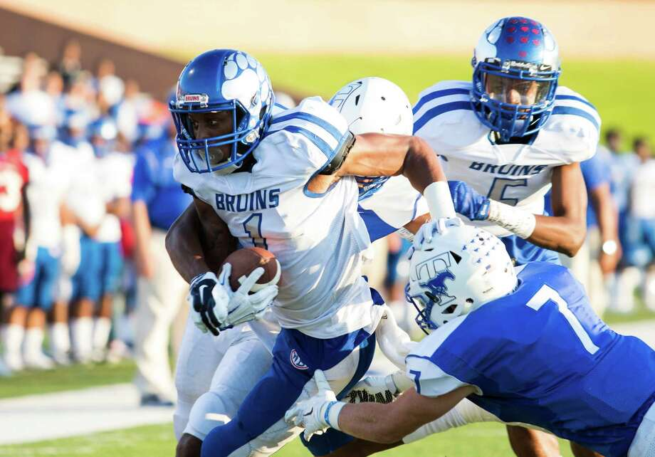 West Brook's Keith Corbin, left, tries to escape the grasp of Taylor's Kelan Winters on Saturday. Corbin had eight catches for 146 yards and two touchdowns. Photo: Joe Buvid, Freelance / © 2015 Joe Buvid