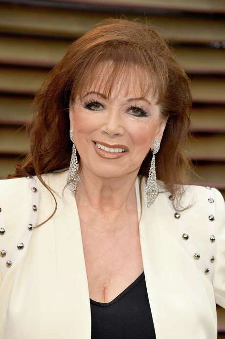 FILE - SEPTEMBER 19: Novelist Jackie Collins has passed away after a battle with breast cancer.  She was 77 years old. WEST HOLLYWOOD, CA - MARCH 02:  Novelist Jackie Collins attends the 2014 Vanity Fair Oscar Party hosted by Graydon Carter on March 2, 2014 in West Hollywood, California.  (Photo by Pascal Le Segretain/Getty Images) Photo: Pascal Le Segretain, Staff / 2014 Getty Images