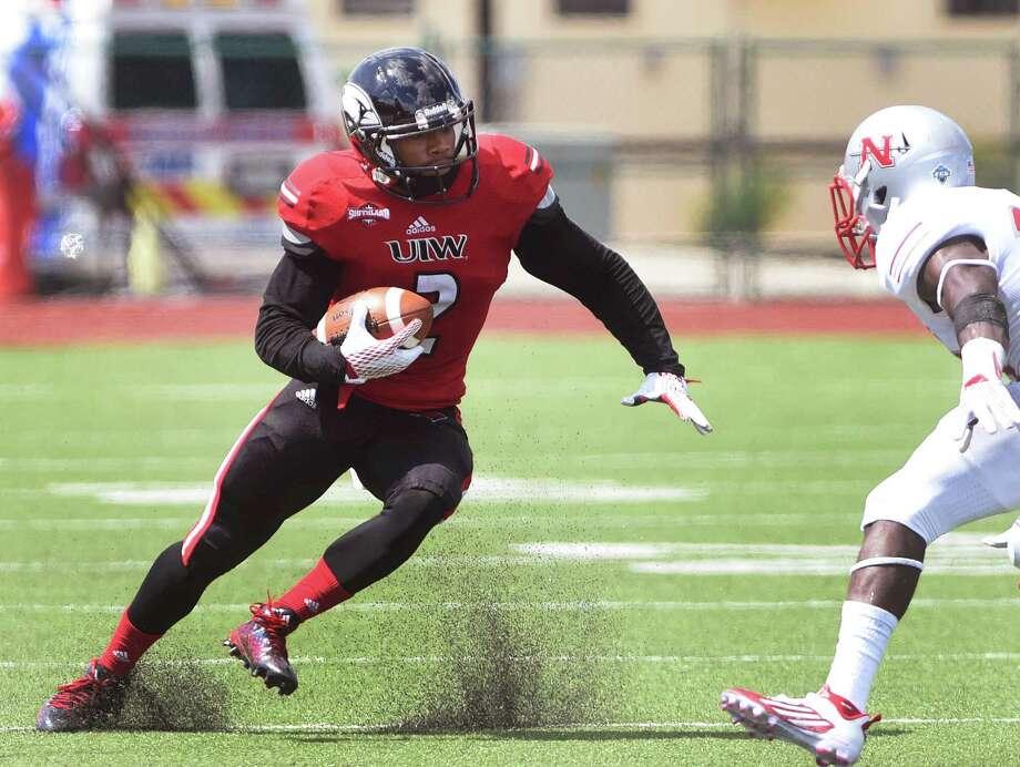 Receiver Jordan Hicks of Incarnate Word dodges Nicholls State defender Darius Knight during college football action at Benson Stadium on Saturday, Sept. 19, 2015. Photo: Billy Calzada, Staff / San Antonio Express-News