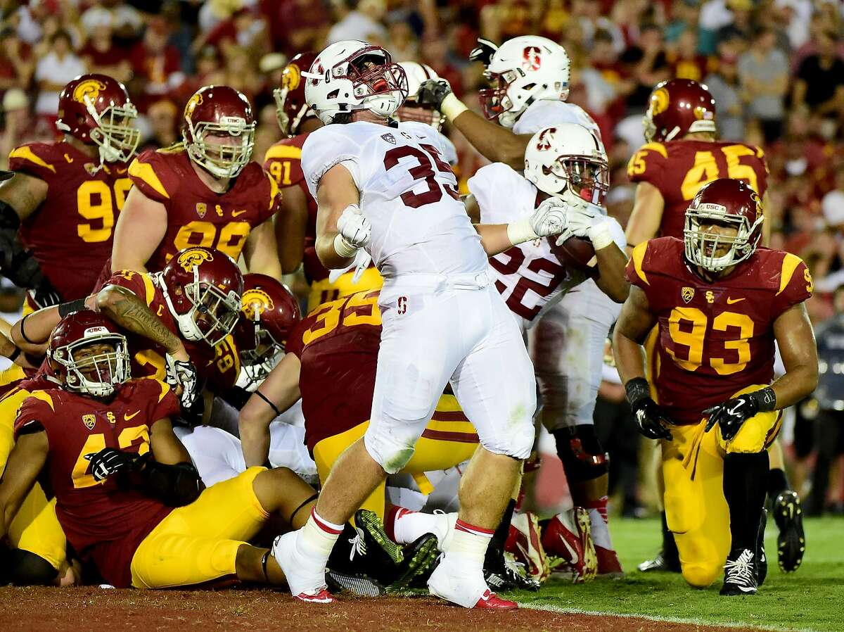 LOS ANGELES, CA - SEPTEMBER 19: Daniel Marx #35 of the Stanford Cardinal celebrates the touchdown of Remound Wright #22 to take a 34-28 lead over USC Trojans during the third quarter at Los Angeles Coliseum on September 19, 2015 in Los Angeles, California.