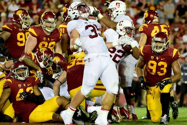 LOS ANGELES, CA - SEPTEMBER 19:  Daniel Marx #35 of the Stanford Cardinal celebrates the touchdown of Remound Wright #22 to take a 34-28 lead over USC Trojans during the third quarter at Los Angeles Coliseum on September 19, 2015 in Los Angeles, California.  (Photo by Harry How/Getty Images)