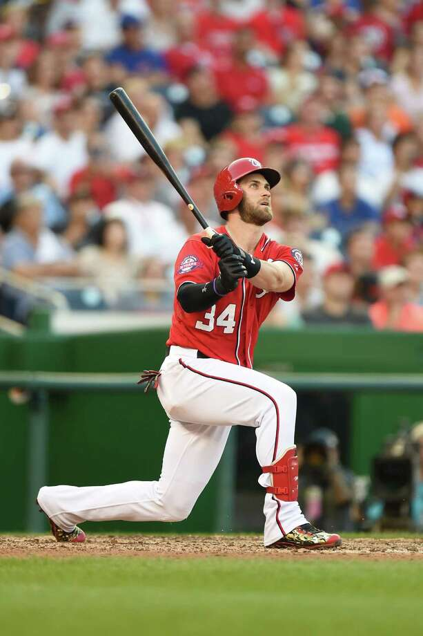 BALTIMORE, MD - SEPTEMBER 19:  Bryce Harper #34 of the Washington Nationals hits a two run home run in the seventh inning during a baseball game against the Miami Marlins at Nationals Park on September 19, 2015 in Washington,DC.  The Nationasl won 5-2.  (Photo by Mitchell Layton/Getty Images) ORG XMIT: 538595141 Photo: Mitchell Layton / 2015 Getty Images