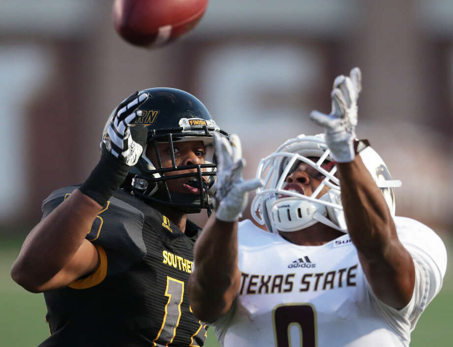Bobcat receiver C.J. Best watches a touchdown pass fly just out of reach as he is covered by Picasso Nelson as Texas State hosts Southern Mississippi at Bobcat Stadium on Sept. 19, 2015. Photo: Tom Reel /San Antonio Express-News / San Antonio Express-News