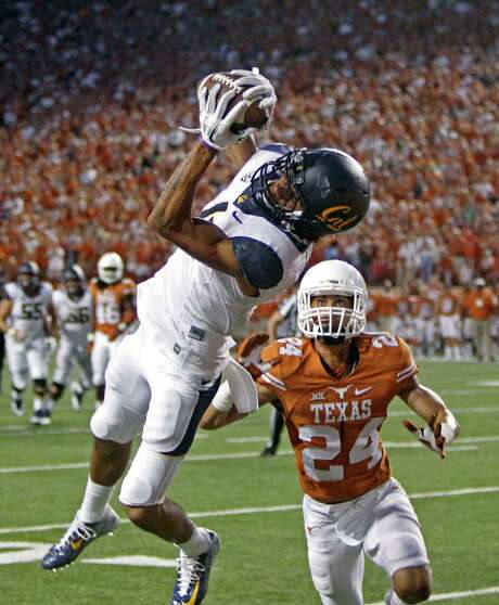 Cal's Kenny Lawler beats  John Bonny for a touchdown, part of a shaky effort by the Texas defense Saturday night. Photo: Michael Thomas, FRE / FR65778 AP