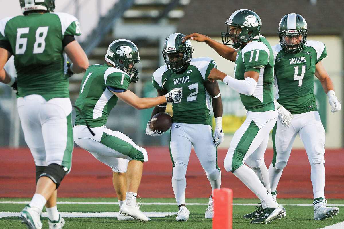 The Reagan Rattlers celebrate Marquis Duncan's (center) 37-yard touchdown reception during the first half of their game with East Central at Comalander Stadium on Saturday, Sept. 19, 2015. MARVIN PFEIFFER/ mpfeiffer@express-news.net