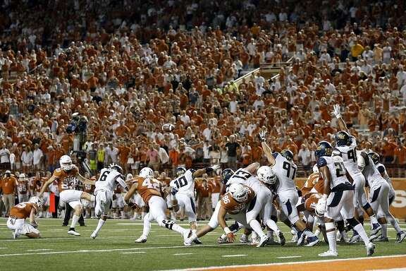 Texas kicker Nick Rose misses an extra point attempt that would have tied the game against California in the fourth quarter of an NCAA college football game in Austin, Texas, Saturday, Sept. 19, 2015.  (Jay Janner/Austin American-Statesman via AP)