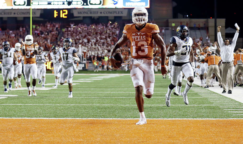 Texas Longhorns' quarterback Jerrod Heard scores a touchdown late in the game against the California Golden Bears Saturday Sept. 19, 2015 at Texas Memorial Stadium in Austin, Tx. The California Golden Bears won 45-44. Photo: Edward A. Ornelas, Staff / San Antonio Express-News / © 2015 San Antonio Express-News