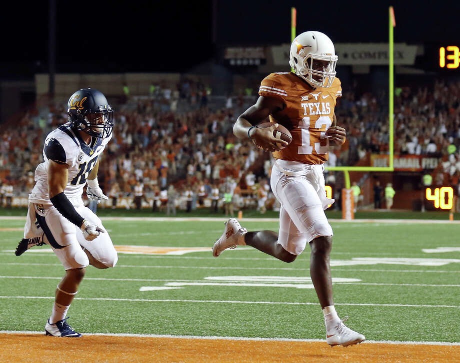 Texas Longhorns' quarterback Jerrod Heard scores a touchdown around California Golden Bears' cornerback Caleb Coleman during second half action Saturday Sept. 19, 2015 in Austin. The California Golden Bears won 45-44. Photo: Edward A. Ornelas /San Antonio Express-News / © 2015 San Antonio Express-News