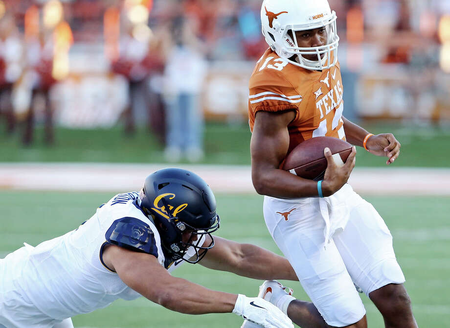 Texas Longhorns' quarterback Jerrod Heard looks for room around California Golden Bears' linebacker Jalen Jefferson during first half action Saturday Sept. 19, 2015 at Royal-Memorial Stadium in Austin. Photo: Edward A. Ornelas /San Antonio Express-News / © 2015 San Antonio Express-News