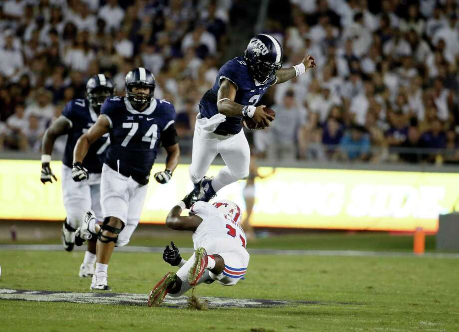 TCU quarterback Trevone Boykin (2) attempts to leap over SMU linebacker Kyran Mitchell (11) in the first half of an NCAA college football game Saturday, Sept. 19, 2015, in Fort Worth, Texas. (AP Photo/Tony Gutierrez) Photo: Tony Gutierrez, STF / Associated Press / AP